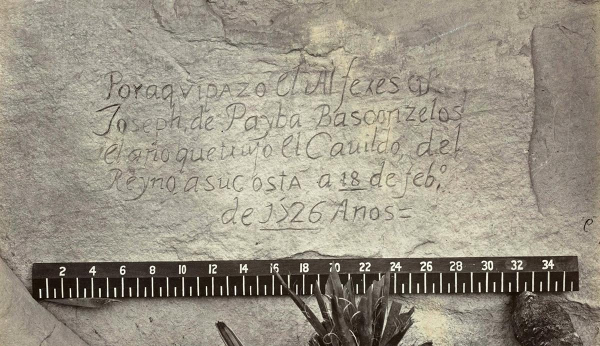 """Spanish inscription from 1726. This close-up view of the inscription carved in the sandstone at Inscription Rock (El Morro National Monument), New Mexico reads, in English: """"By this place passed Ensign Don Joseph de Payba Basconzelos, in the year in which he held the Council of the Kingdom at his expense, on the 18th of February, in the year 1726"""""""