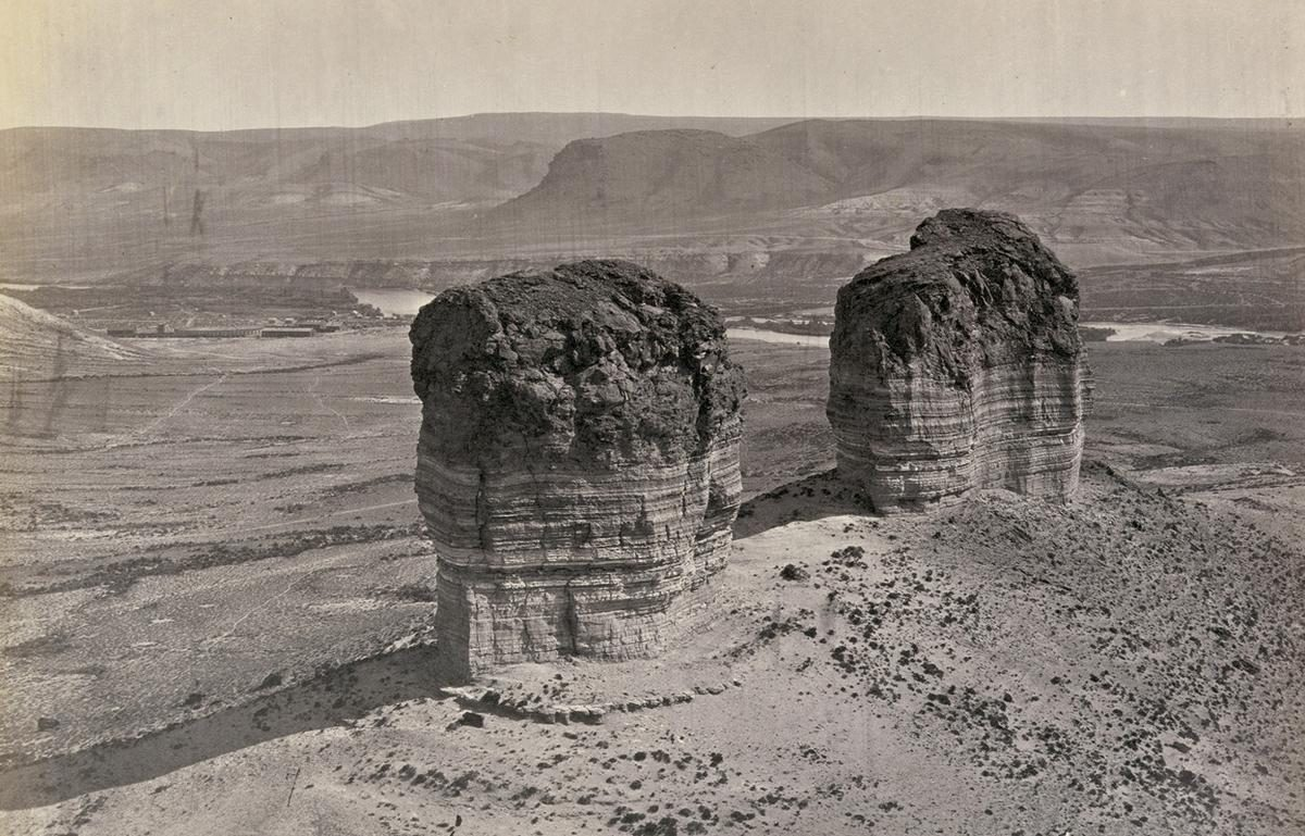 Twin buttes stand near Green River City, Wyoming, photographed in 1872