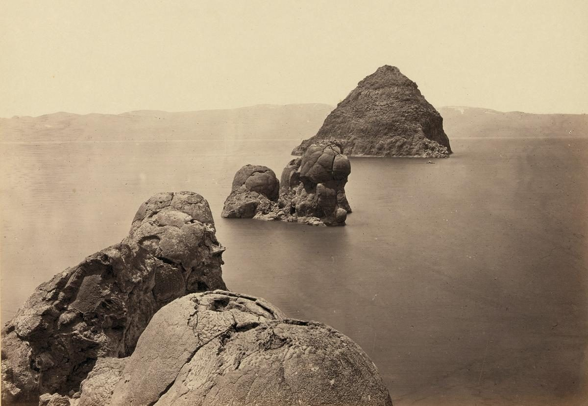 The Pyramid and Domes, a line of dome-shaped tufa rocks in Pyramid Lake, Nevada, seen in 1867