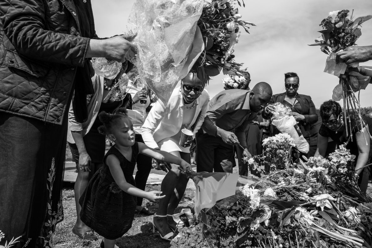 amily members 'dress' Floris's grave with flowers as part of a traditional Jamaican funeral.