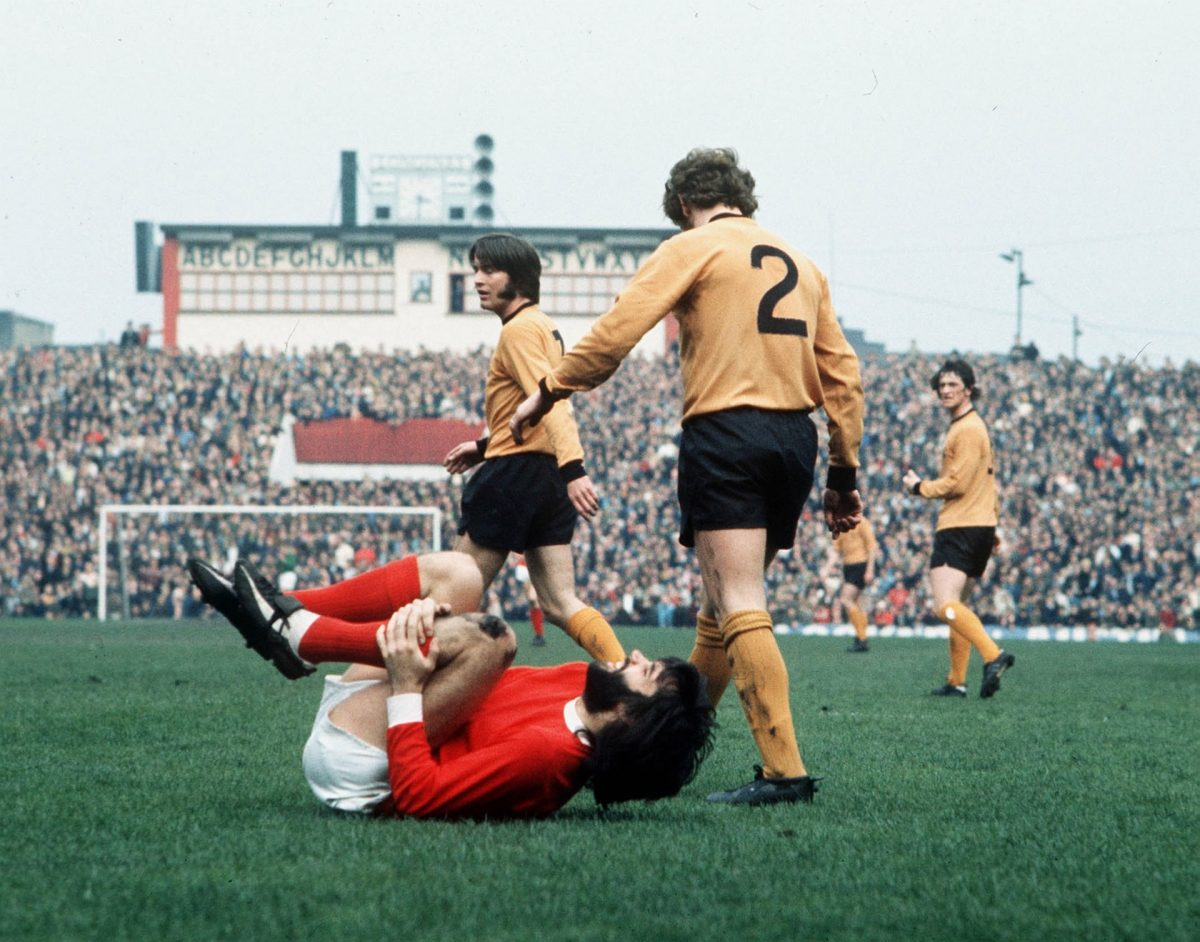 football George Best writhes in agony after being fouled by a Wolves defender. Photograph: Bob Thomas/Getty Images