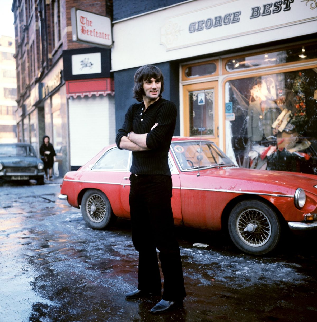 Manchester United and Northern Ireland footballer George Best at his Manchester boutique. Photograph: PA Archive