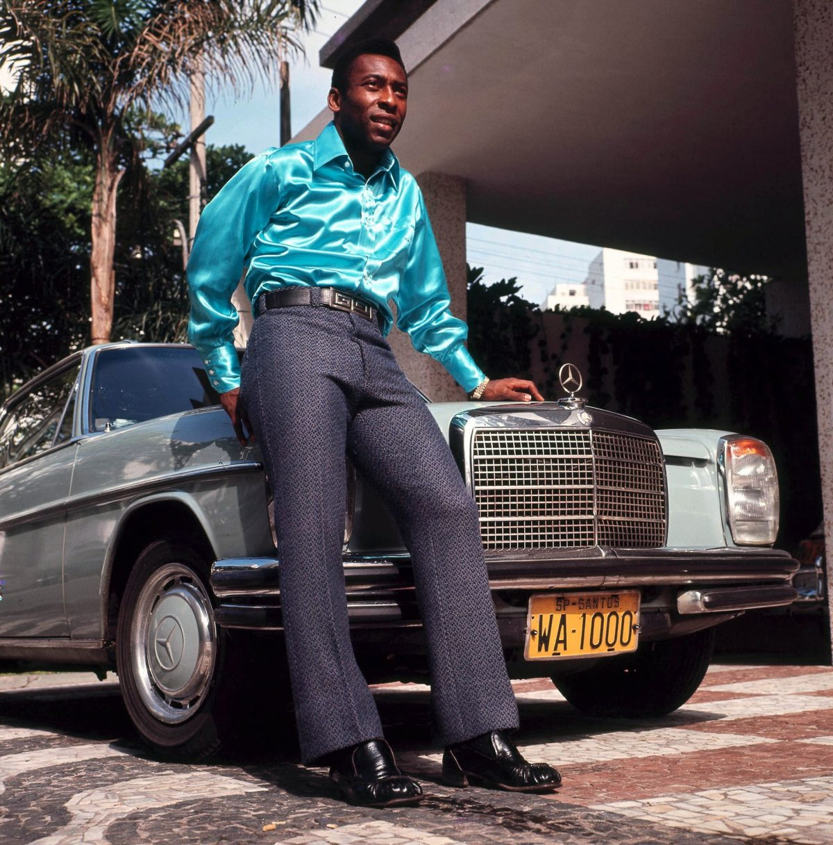 Pele, the star of Brazil's 1970 World Cup-winning team, poses in front of a Mercedes. Photograph: Popperfoto/Getty Images