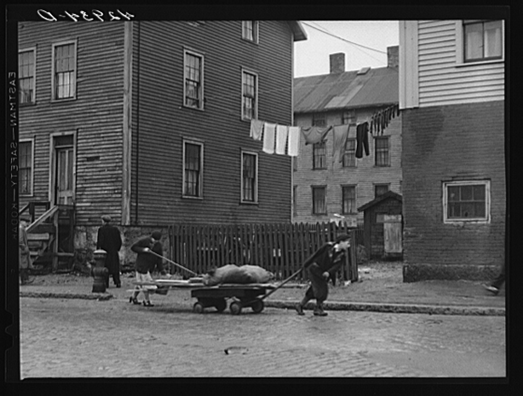 Bringing home some salvaged firewood in slum area in New Bedford, Massachusetts Jan 1941