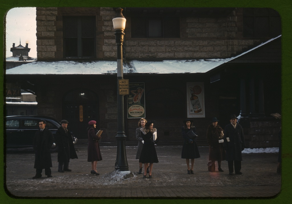 Commuters, who have just come off the train, waiting for the bus to go home, Lowell, Mass. Jan 1941