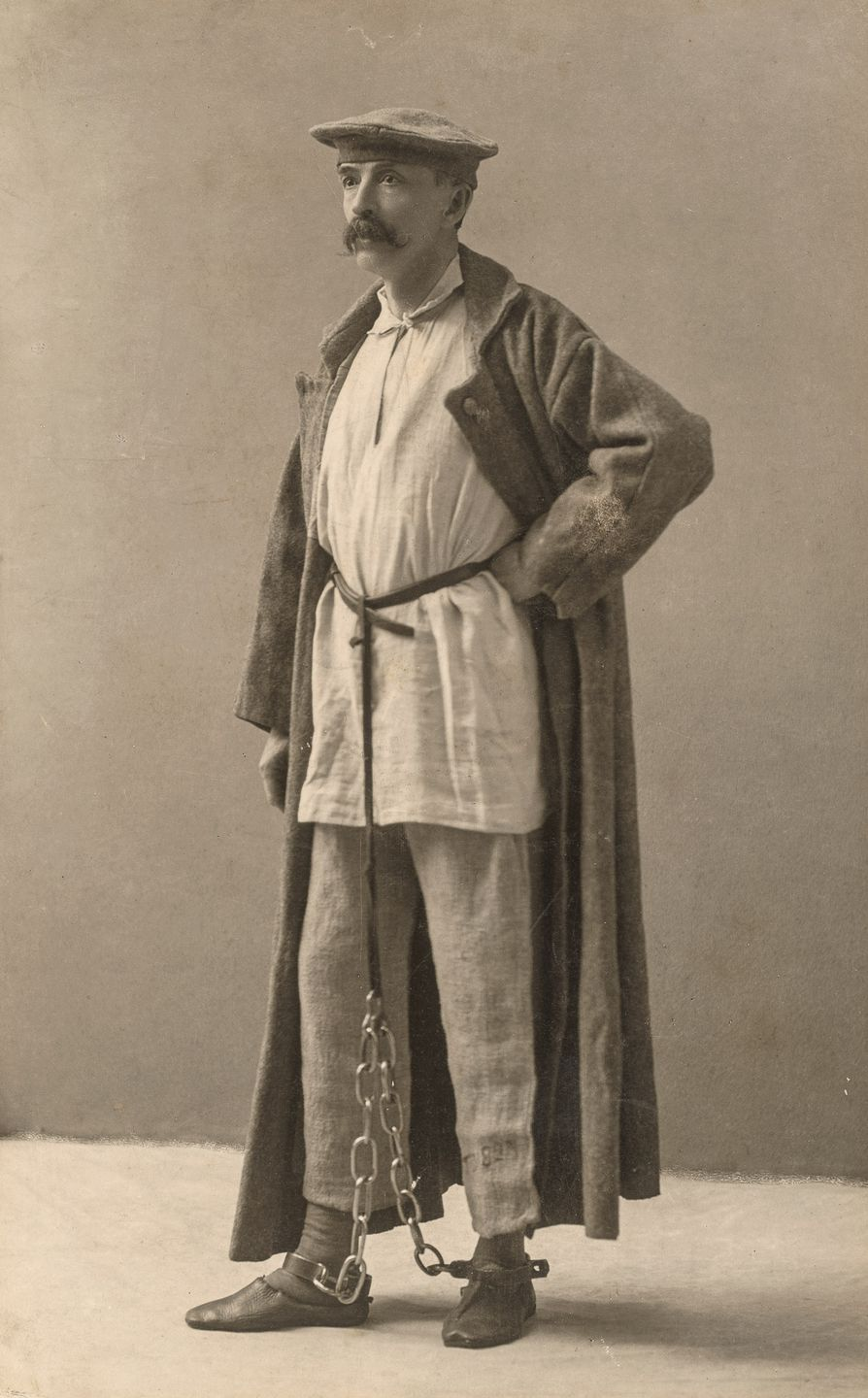 George Kennan poses in Siberian exile dress, each piece given to him by an exile from the dress he had worn