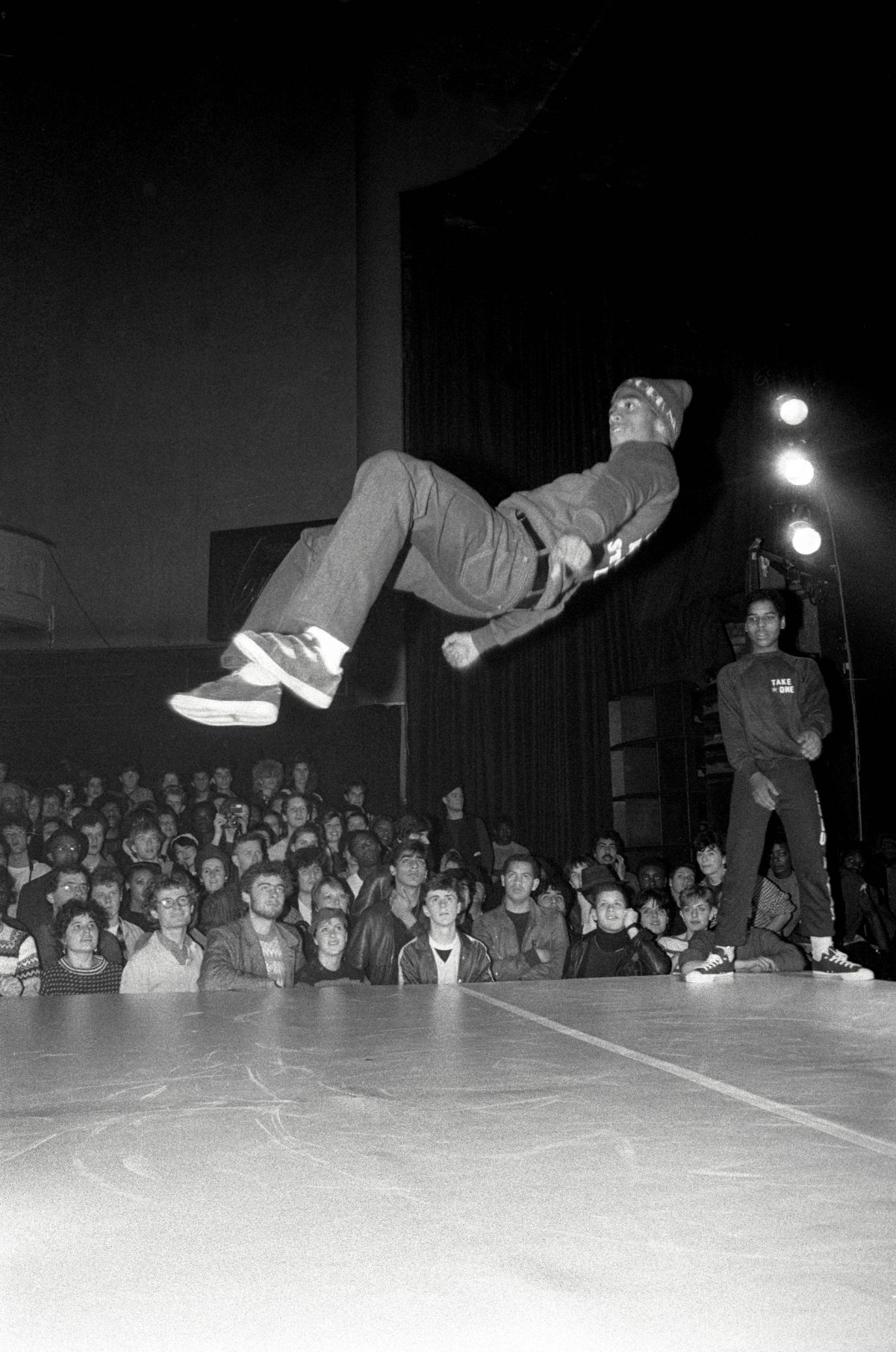 A breakdancer from Rock Steady Crew at the Venue in London, 1982 David Corio was covering one of the first hip-hop events in London, featuring Rock Steady Crew, and shot Wayne 'Frosty Freeze' Frost mid-air. He recalls: 'This show was probably the first time almost anyone in the audience had seen people spinning round on their backs and heads and almost floating in the air. I love the look of wonderment on the faces in the crowd' Photograph: David Corio/Redferns