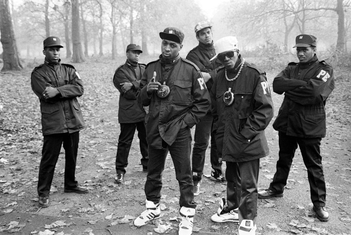 Public Enemy in Hyde Park, London, 1987 'Public Enemy were the support act on a bill with LL Cool J and Eric B & Rakim,' says Corio. 'This was their first morning in a foggy London and I persuaded them to go to the park. Their main concern was that they hadn't seen any McDonald's on their way from the airport so were worried about what they were going to eat. Without me asking, they started posing and making Black Power signs, which somewhat bemused the old ladies walking their dogs that were passing by' Photograph: David Corio/Redferns