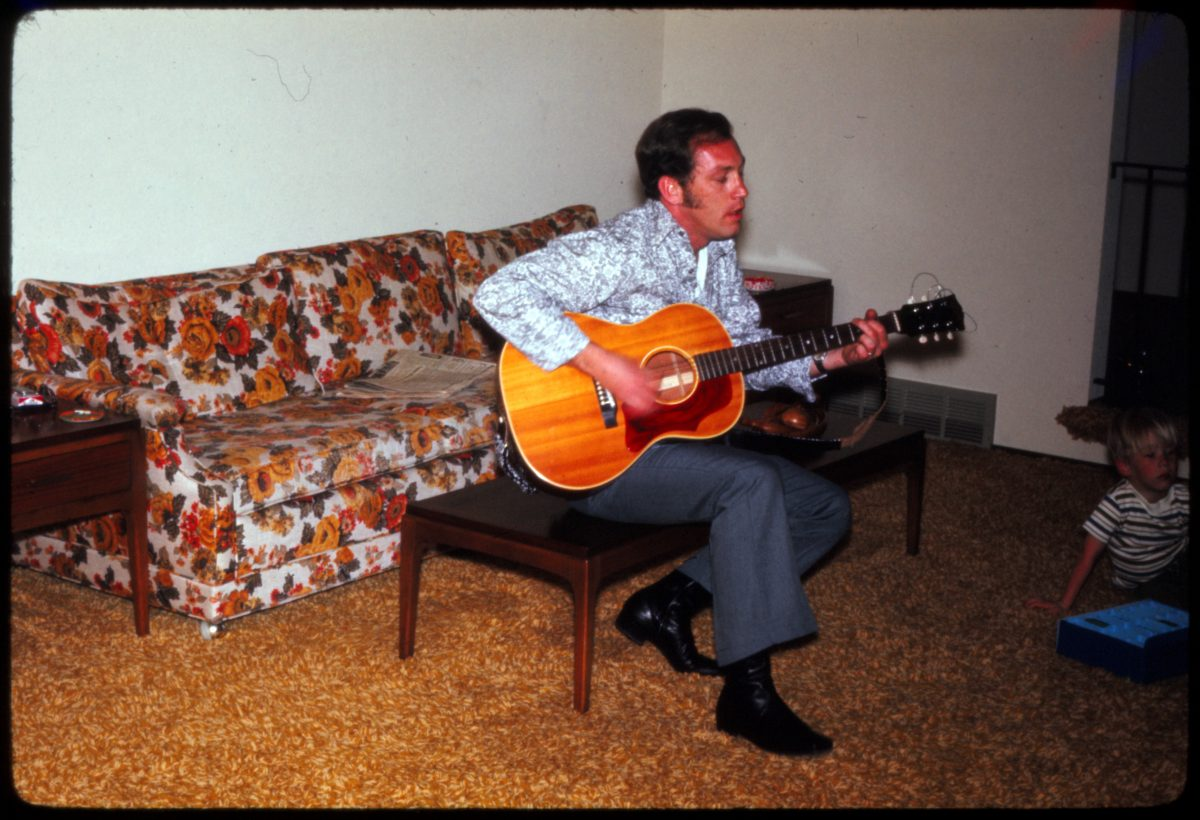 Jack Playing Guitar - 5 April 1971 Father in law in the living room, strumming out a song on his Gibson B25. Kodak Ektachrome slide, taken by his Mom. My wife still has this guitar.