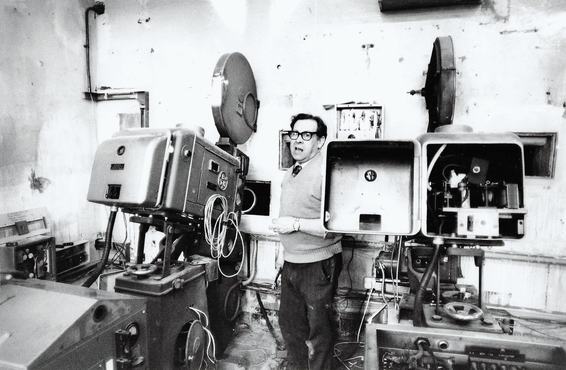 Billy Bell, technician installing projection equipment at Scala King's Cross, 1981 Photograph- David Babsky