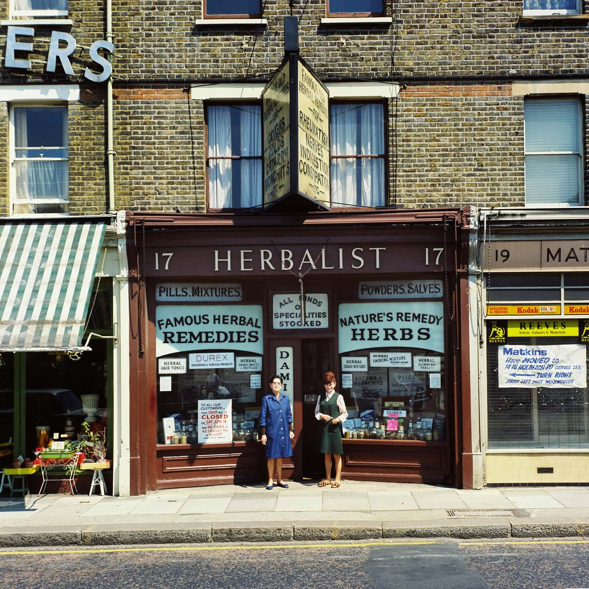 Mrs McArthy and her daughter outside the London herbalist in Stanley Road, June 1975.