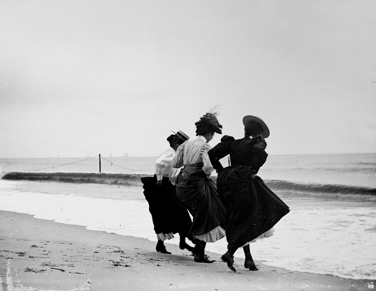 Sept. 8, 1897 Gertrude Hubbell, Ruth Peters, and Mildred Grimwood play near the water at Arverne, Queens.
