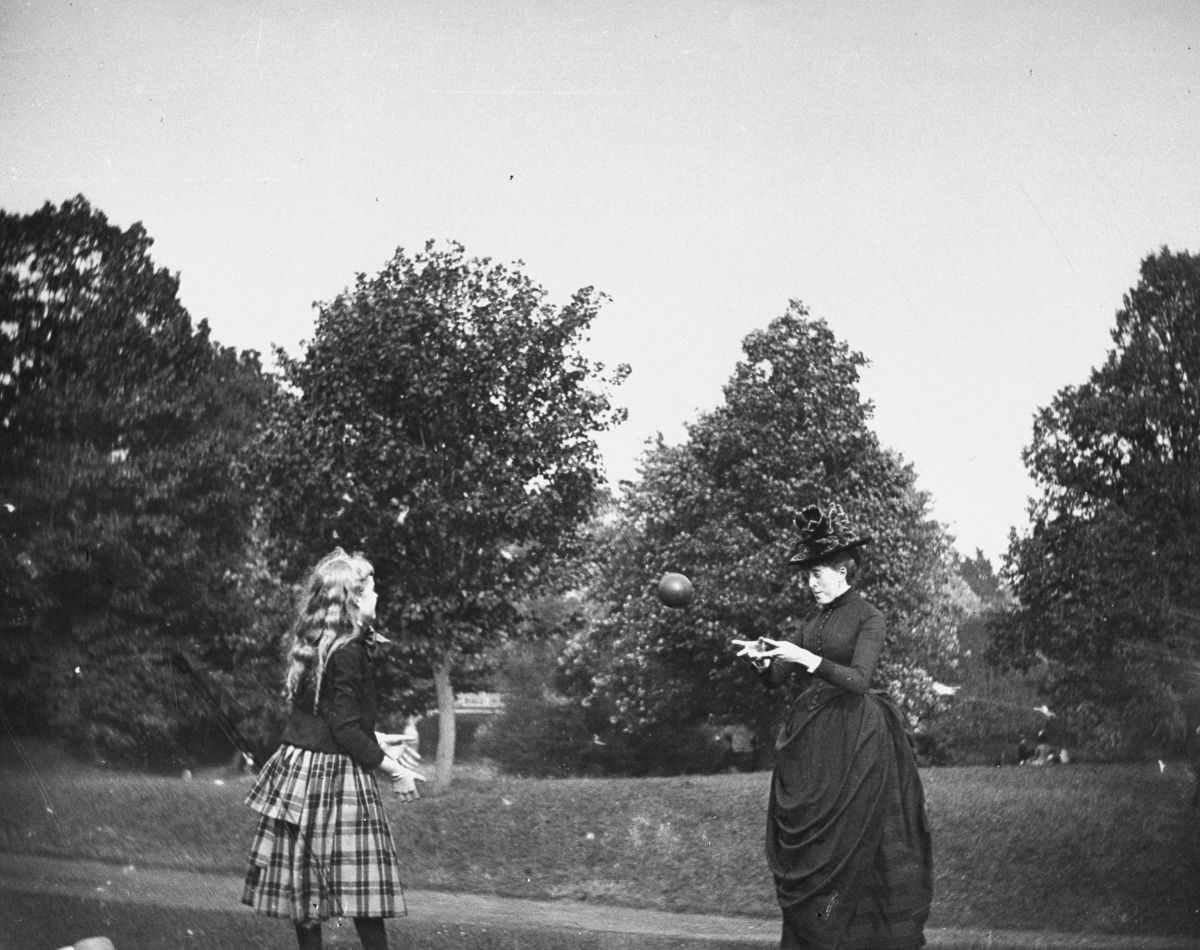 July 20, 1886 Zelma Levison and her aunt Jo Grimwood throw a ball back and forth on a lawn in Prospect Park.