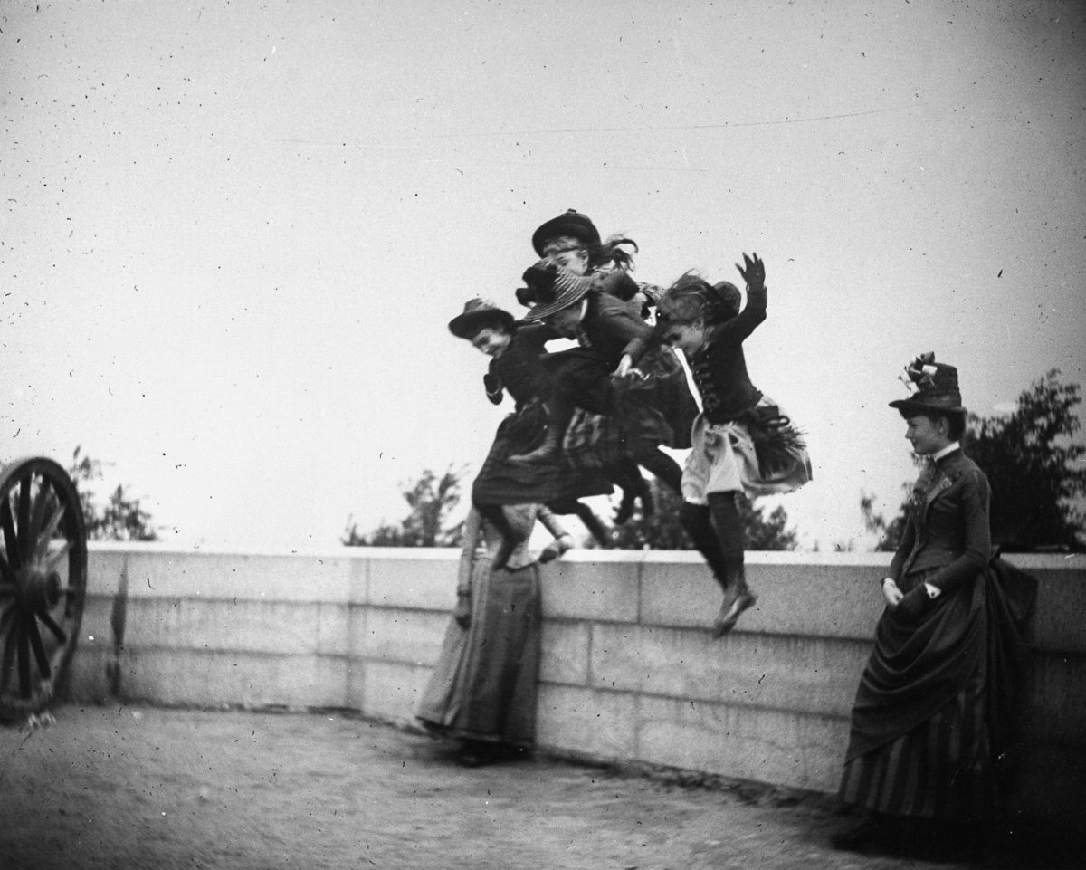 May 22, 1886 Girls jump off a stone wall in Fort Greene.
