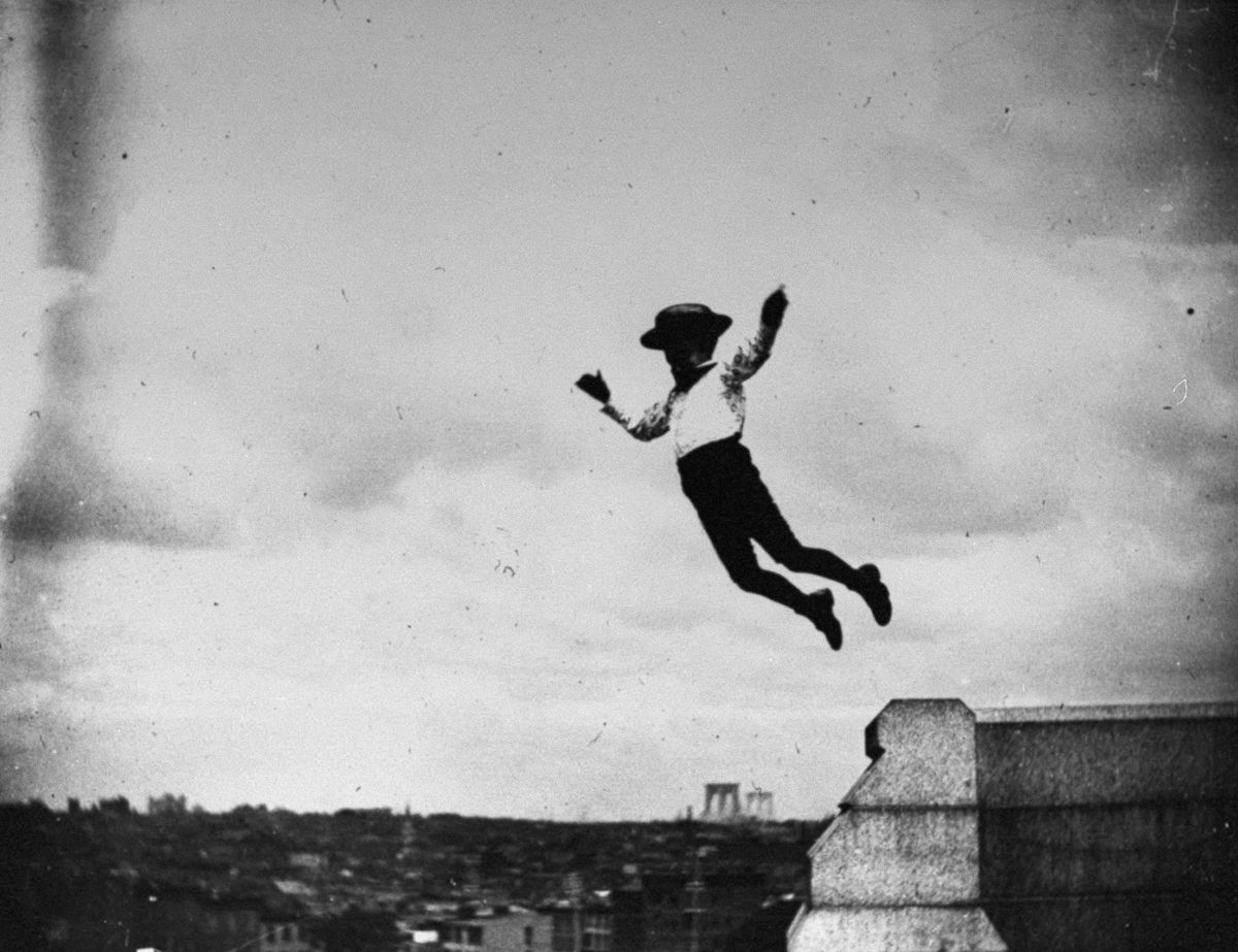 June 26, 1886 Jamie Swan jumps off a short stone wall at Fort Greene Park in Brooklyn.