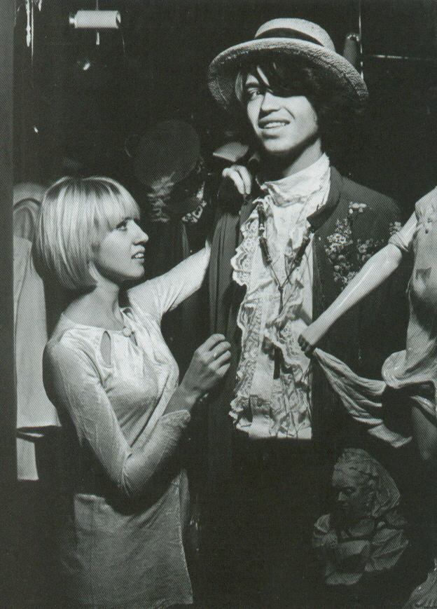 Mary Roberts - wife of designer Tommy (wearing velvet mini which she adapted from an antique wedding dress) and Nicholas Constantine Spinney in an antique embroidered jacket in Carnaby Street boutique Kleptomania, 1967