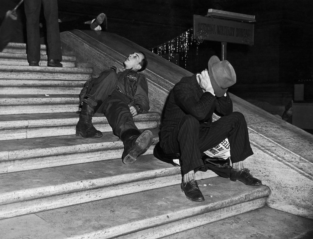 Jan. 1, 1940 Revelers recover on the steps of Grand Central Station in New York after New Year's Eve celebrations.