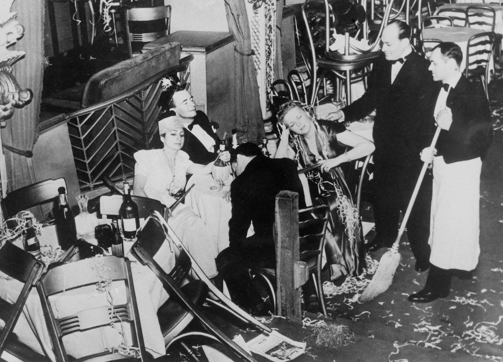 Jan. 1, 1940 Employees of the Diamond Horseshoe in New York clean after a New Year's party.