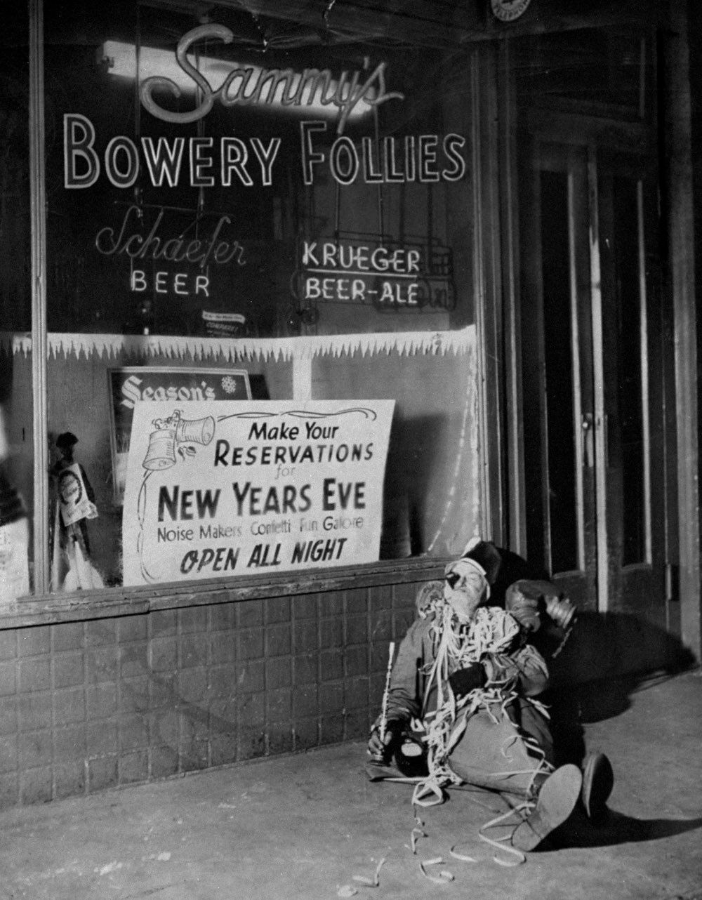 Jan. 1, 1952 A gentleman sits outside the Bowery after he wasn't able to get a seat to celebrate New Year's Eve at Sammy's Bowery Follies in New York.