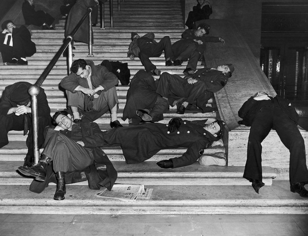 Jan. 1, 1940 Revelers recover from New Year's Eve celebrations on the steps of Grand Central Station in New York.