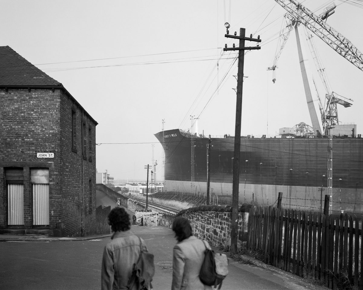 Shipyard workers looking at the Everett F Wells, Wallsend, 1977.Given by the artist in honour of all the shipyard workers of Tyneside, 2017