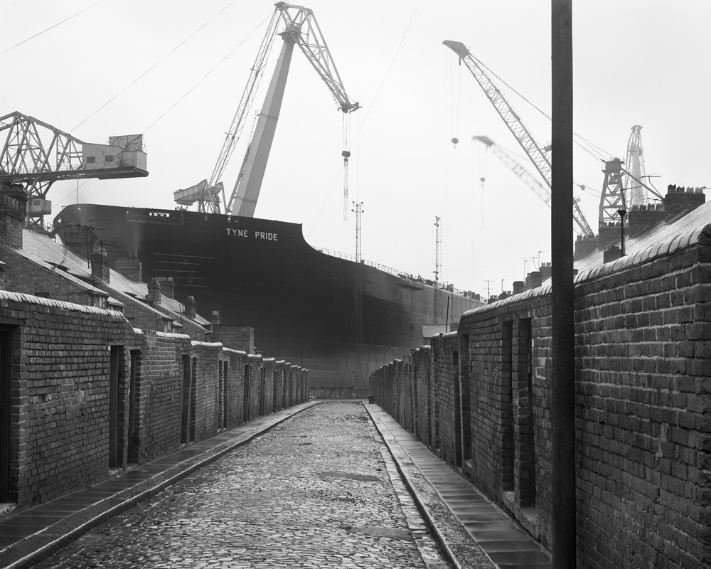[TWCMS_2017_79] Tyne Pride from a back lane, Wallsend, 1975. Givenby the artist in honour of all the shipyard workers of Tyneside, 2017© Chris Killip