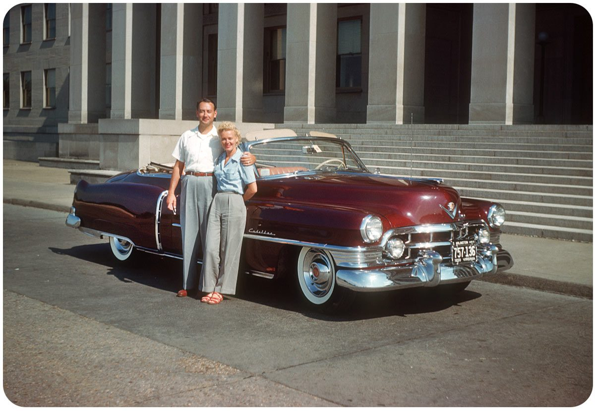 Cadillac in D.C. — 1950s Marilyn Monroe look-alike and husband strike an all-American pose with the new car, a 1952 Cadillac convertible in rich burgundy with natural interior.
