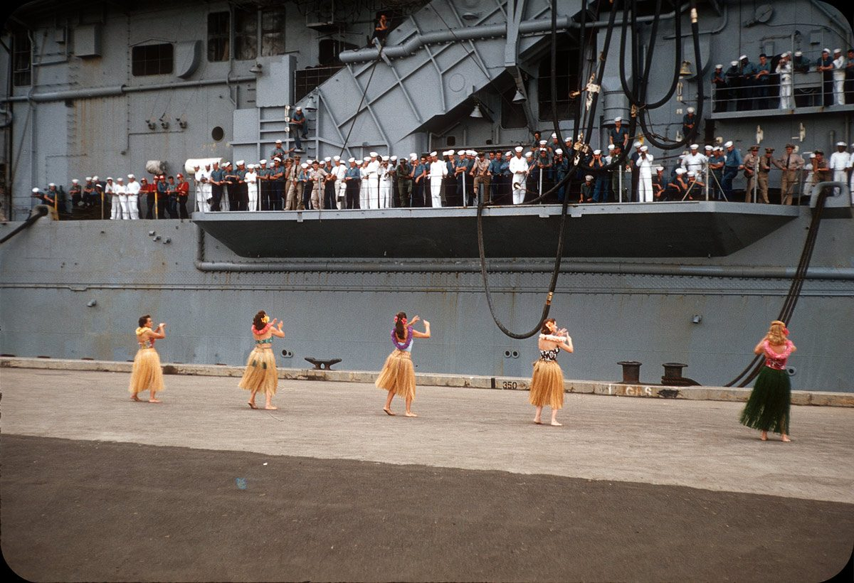 Welome Home Hula Dance on Ford Island, Honolulu, Hawaii – 1950s That's the USS Shangri-La, which saw a lot of action in WWII. It was (or still is?) a tradition that the wives of airmen greet incoming ships with a traditional Hawaiian hula dance.