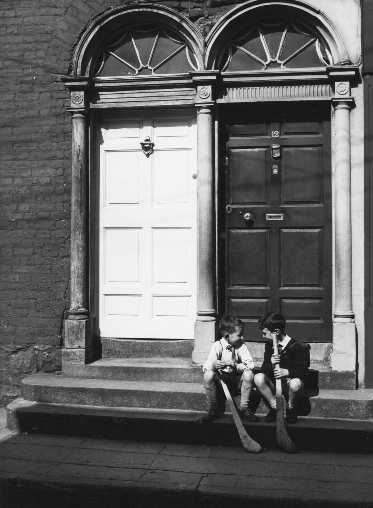 Two boys on a doorstep, Kilkenny, Ireland, 1965.