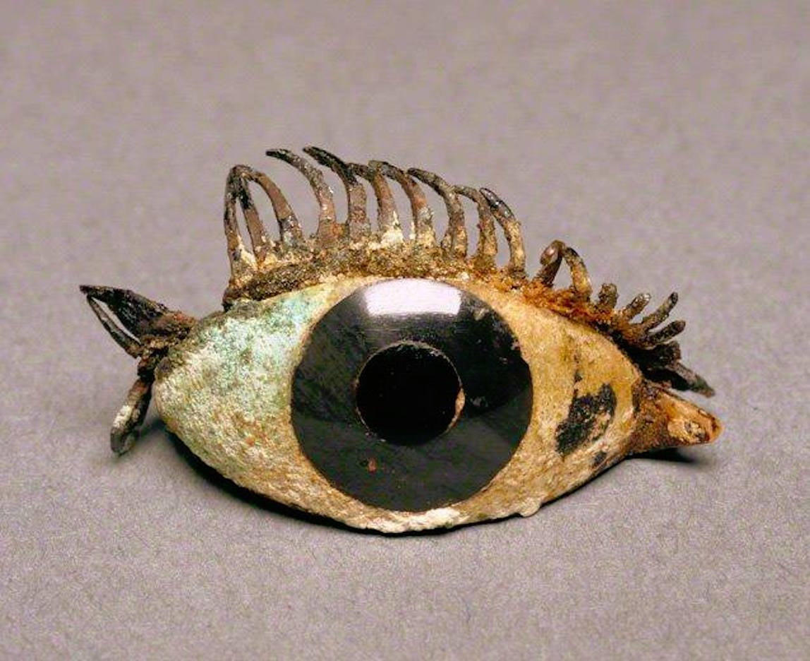 mage: Right eye from a Greek statue, ca. 500–100 BCE. Marble, obsidian, glass and copper.)