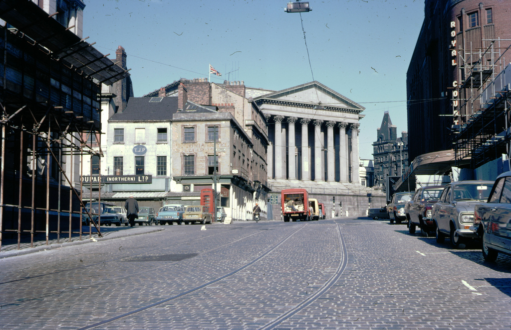1969 LIVERPOOL Tram rails remaining in street, Liverpool, England shows facade of the St. George's Hall.