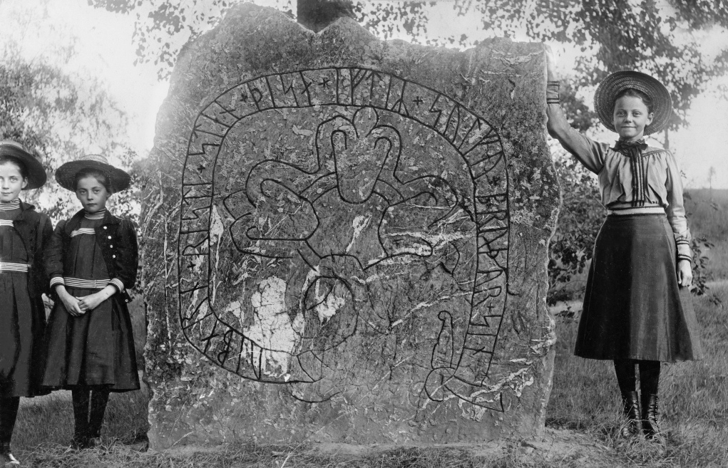 "Rune stone, Herstadberg, Östergötland, Sweden Three girls at a runestone (Ög 46) on Ströbo meadow at Herrstaberg. The inscription says: ""Vibern raised this stone in memory of Solva, his brother."""