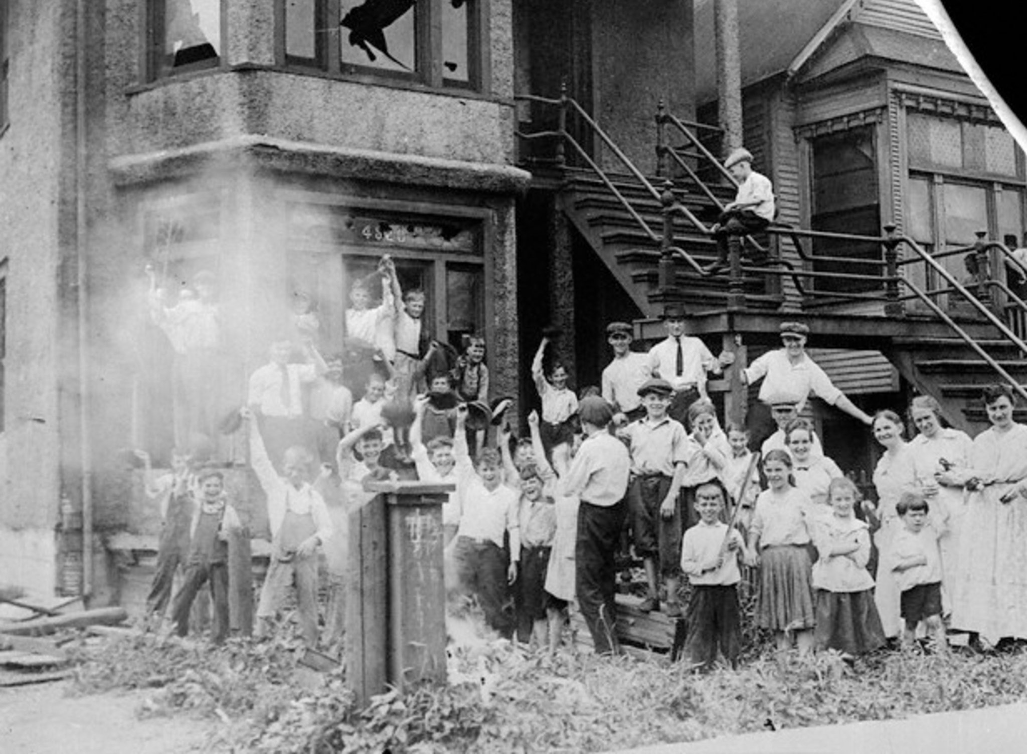 kids-cheering-a-burning-house.jpg