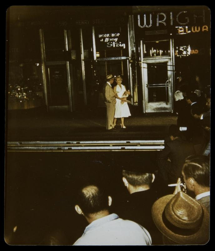 An original color photograph of Marilyn Monroe and co-star Tom Ewell on the set for The Seven Year Itch (20th Century, 1955), filming the now famous skirt-blowing subway scene from the film, shot on September 15, 1954. Fans and photographers can also be seen in this photo. This photograph is likely never before seen. 4 3/4 by 3 1/2 inches PROVENANCE From the Estate of Frieda Hull