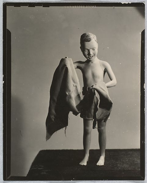 Morton Bartlett (American, 1909–1992) [Painted Plaster Figure of Boy on Beach with Towel], ca. 1950 Gelatin silver print; 11.4 x 8.9 cm (4 1/2 x 3 1/2 in. ) The Metropolitan Museum of Art, New York, Gift of Marion Harris