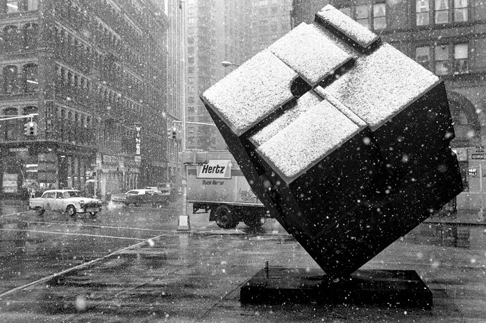 "Snowing over Astor Place, 1978 At Astor Place, East Village, Manhattan, NY 1978 *15' high steel cube is an artwork titled ""Alamo"" by Tony (Bernard) Rosenthal"