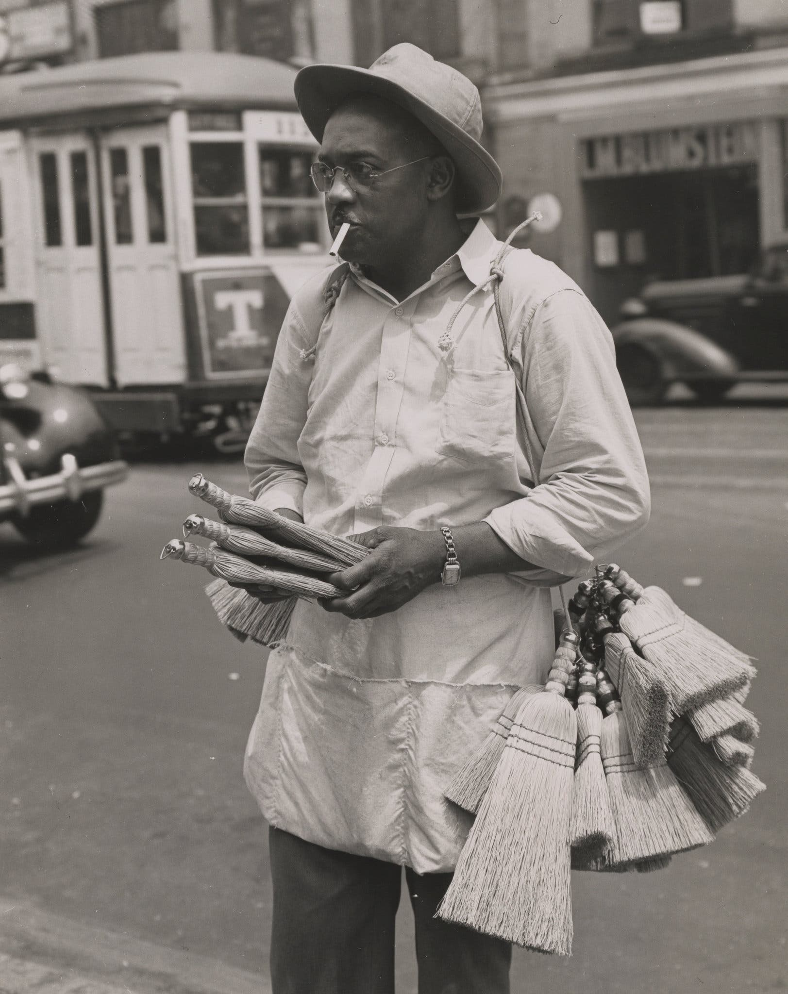 New York City 1940s 1950s A whisk broom salesman on 125th Street. 1946.