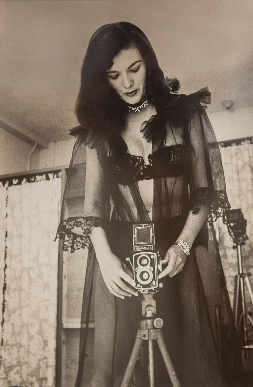 "Bunny Yeager, ""Bunny Yeager in Black Lace with Her Rolleiflex Camera,"" 1955, Silver gelatin print"