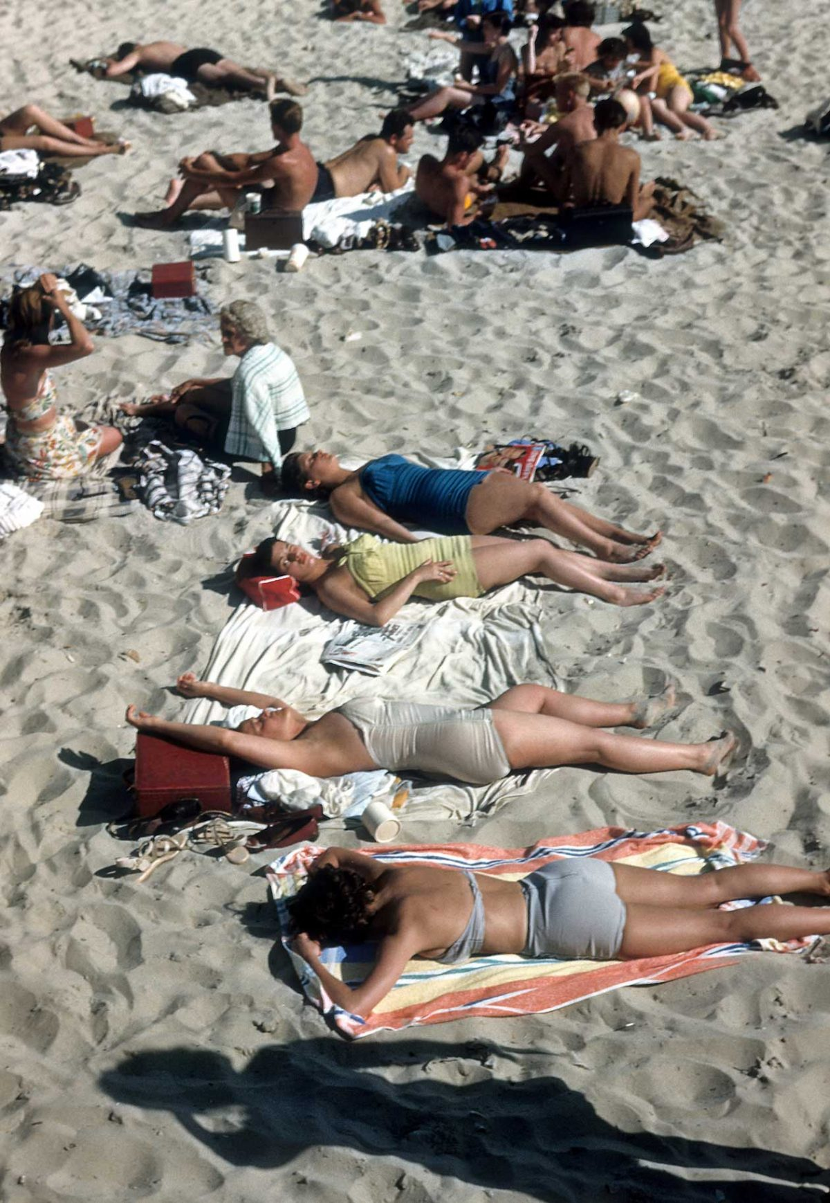 NEW YORK - CIRCA 1948: Sunbathers on Coney Island beach circa 1948 in Brooklyn, New York City, New York. (Photo by Sherman Oaks Antique Mall/Getty Images)
