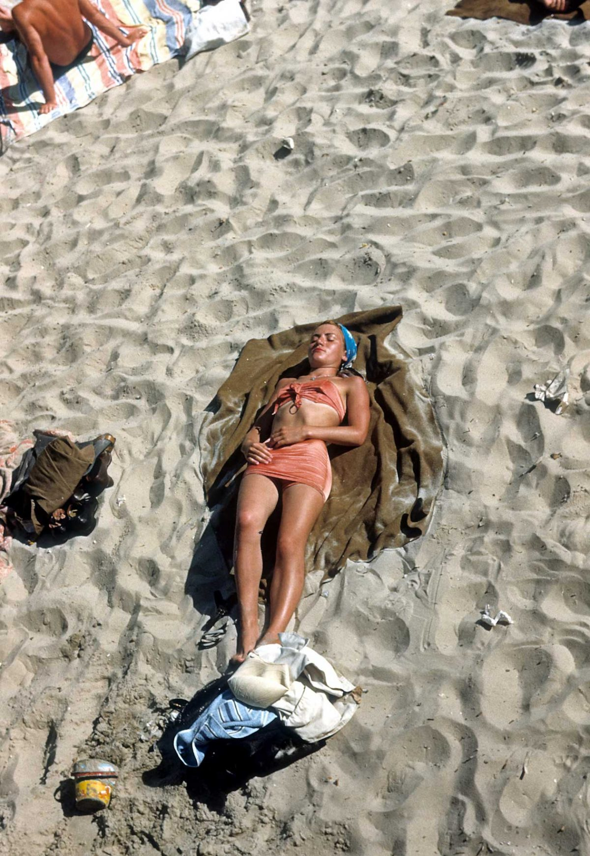 NEW YORK - CIRCA 1948: A woman sunbathes on Coney Island beach circa 1948 in Brooklyn, New York City, New York. (Photo by Sherman Oaks Antique Mall/Getty Images)