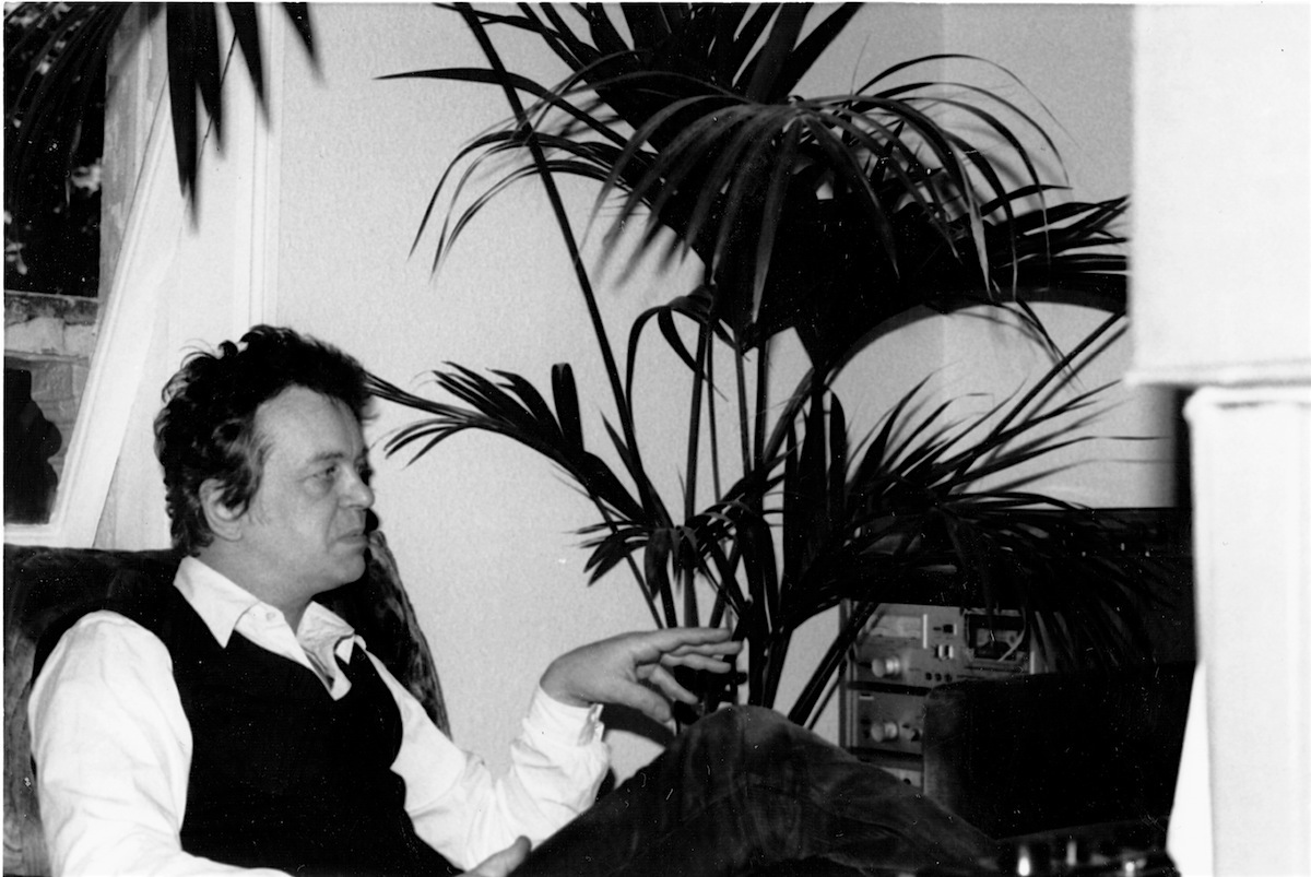 Derek Marlowe avoiding the clutch of a triffid while being interviewed at his apartment in London 15th June 1984.