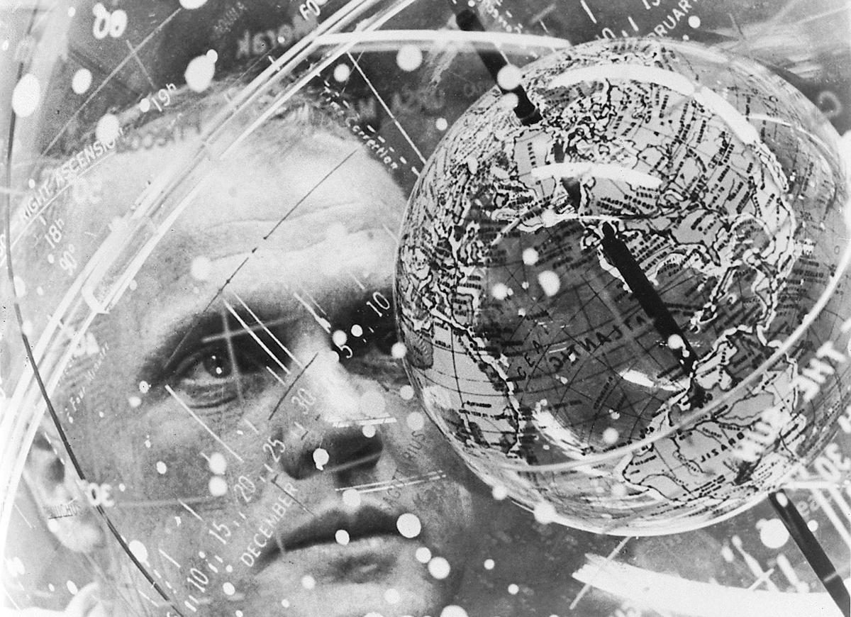 John H. Glenn Jr. studies a Celestial Training Device (concentric globes) at the Aeromedical Laboratory at Cape Canaveral, Florida - February 1962
