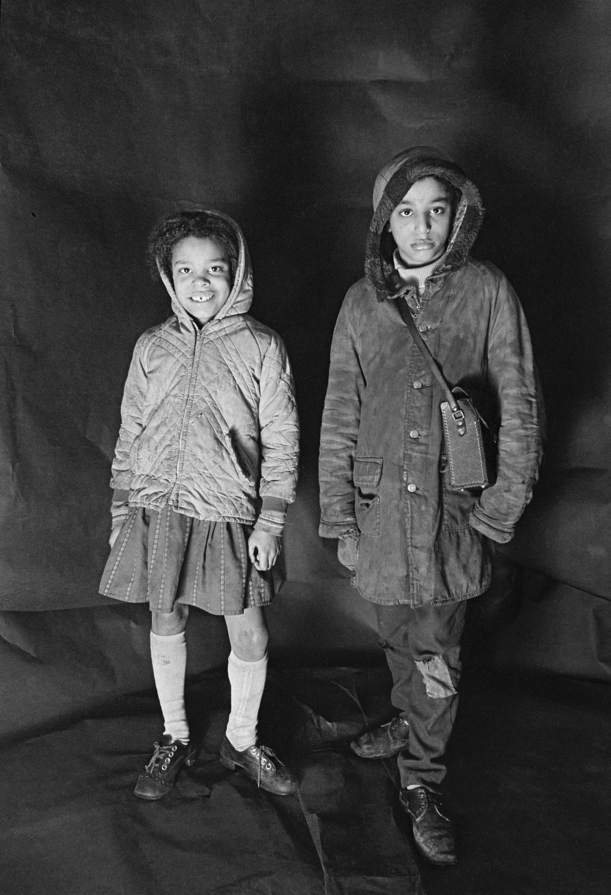 Portrait of Angela Loretta Lindsey, aged 8, with her brother Mark Emanuel Lindsey in Meadows's free photographic studio at no.79B Greame Street, Moss Side, Manchester, February - April 1972.