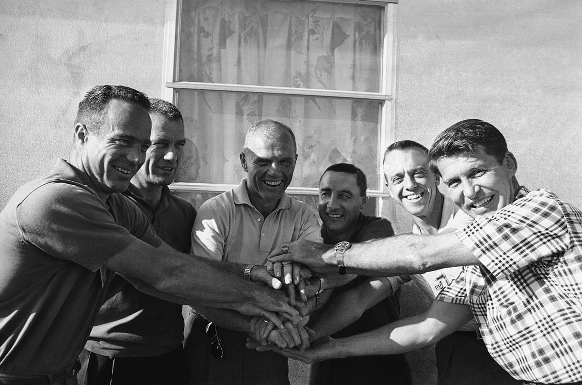 John Glenn, center, is greeted by fellow astronauts following his orbital flight, February 23, 1962 on Grand Turk Island, Turks and Caicos Islands. From left to right is: Scott Carpenter, Donald Slayton, Glenn, Virgil Grissom, Alan Shepard and Walter Schirra. The seventh member of the astronaut team, Leroy Cooper, was not available