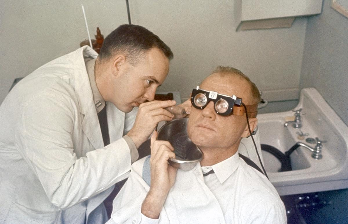 Astronaut John Glenn Jr.'s balance mechanism (semi-circular-canals) is tested by running cool water into his ear and measuring effect on eye motions (nystagmus)