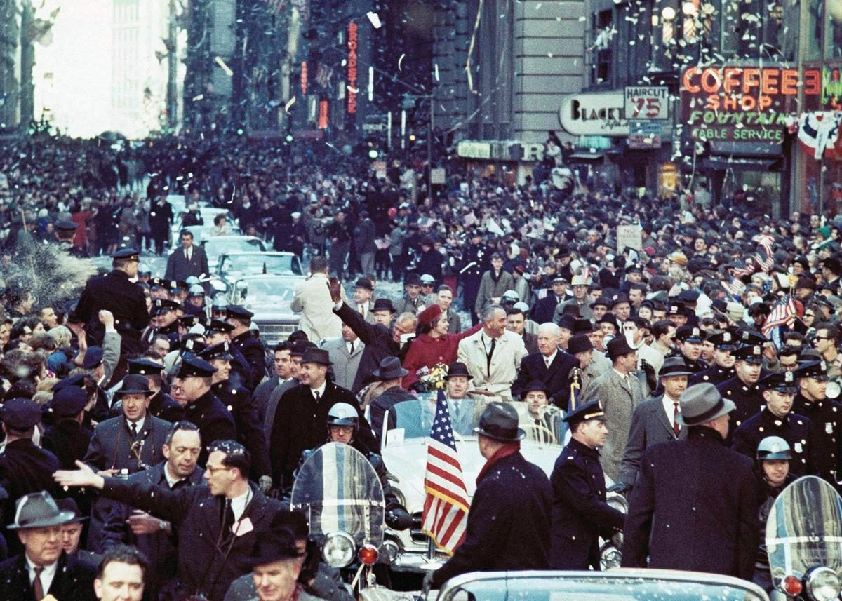John Glenn, his wife Annie, and Vice President Johnson attend a ticker tape parade on March 1, 1962 in New York City