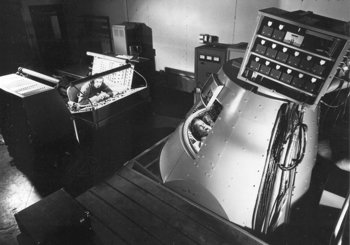 Mercury 7 astronaut John H. Glenn in the Mercury Procedures Trainer at the Space Task Group, Langley Field, Virginia.