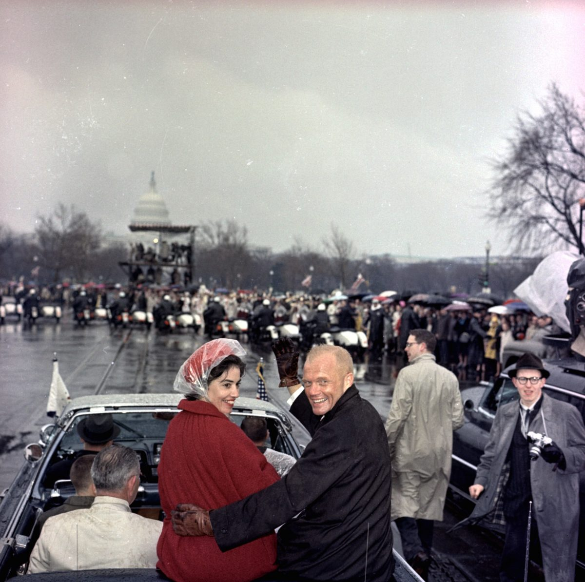 Mercury astronaut John Glenn and his wife, Annie, ride in the back of an open car with Vice-President Johnson during a parade in Glenn's honor in Washington.