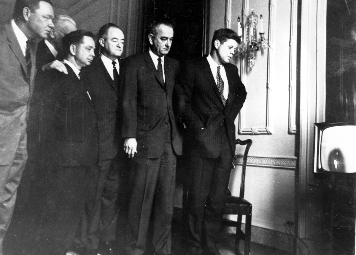 U.S. President John F. Kennedy, right, and Democratic congressional leaders watch the Atlas rocket and the newly-manned Mercury spacecraft blast off at Cape Canaveral, Florida, on a television set in the White House in Washington, District of Columbia, on February 20, 1962. From left are, Rep. Hale Boggs, Louisiana; House Speaker John McCormack, Massachusetts, partially hidden; Rep. Carl Albert, Oklahoma; Sen. Hubert Humphrey, Minnesota; Vice President Lyndon Johnson and Kennedy