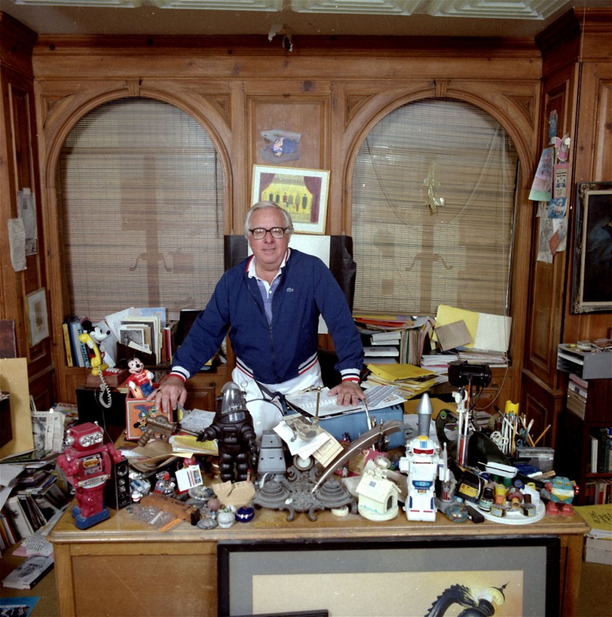 "Ray Bradbury, although one of America's most popular and prolific storytellers, has never had his own television series. He has now reached the home screen in his own series, ""The Ray Bradbury Theater,"" on Home Box Office. He's shown in his Beverly Hills office in February 1986, surrounded by an unlimited supply of toys and treasures."